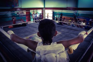 Mauricio Baltodano, a 13-year-old amateur boxer, stands inside the ring at the Roger Deshon gym in Managua. (Mathias Meier/MEDILL)