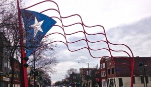 "Steel flags demarcate the Paseo Boricua, ""Puerto Rican Promenade,"" on Division Street in Humboldt Park. (Rebekah Frumkin/MEDILL)"