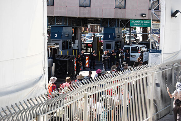 Migrants and travelers wait in line at the Nogales port of entry, the second largest Border Patrol station in the United States. (Alexa Mencia/MEDILL)