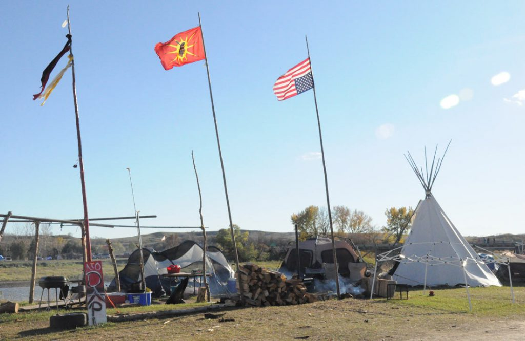 Teepees and tents line the Cannonball River at Standing Rock protests against the construction of the Dakota Access Pipeline in North Dakota. (Cloee Cooper/MEDILL)