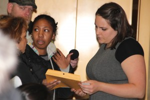 Becky Brasfield gives consumers' letter to a representative of Mayor Emanuel. Photo by Kari Lydersen