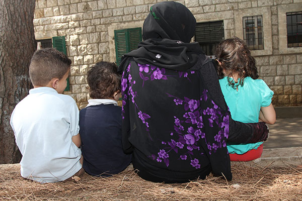 Mayssa and her children outside the CRS-supported shelter for Syrian refugee women who are victims of sexual and gender-based violence. The ongoing Syrian civil war has led to the largest forced migration since World War II. More than half of the estimated 1.1 million Syrian refugees living in Lebanon are women and children. Beyond straining government resources, this influx of Syrian refugees into Lebanon has created a need for additional support services that go beyond providing emergency relief. A particular area of need relates to the protection of vulnerable women from sexual and gender-based violence (SGBV). Research indicates that as living conditions continue to deteriorate and resources become exhausted, Syrian refugees and impoverished host communities resort to negative coping strategies. Through Caritas Lebanon, CRS supports two shelters for SGBV victimsÑone for Syrian refugees and one for Iraqi refugees. CRS also provides SGBV victims with cash assistance, legal assistance and psychosocial support.