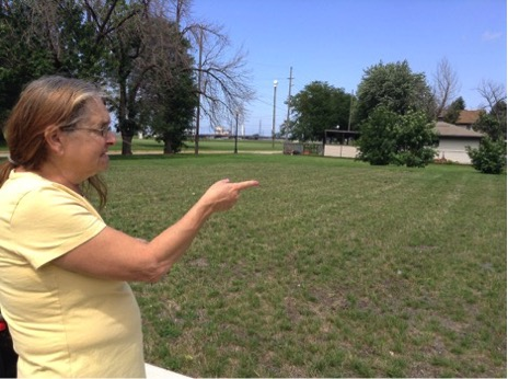 """""""This used to be a nice looking single home where I cut the grass when I was 13,"""" said Rodriguez on August 18, of the vacant lot that the BP oil refinery in Whiting, Indiana now owns. (Cloee Cooper/Medill)"""